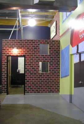 LIMELIGHT NETWORKS mural sponged brick facade of sales office as a butcher shop seamless integration of design into mural fLANSBURG dESIGN