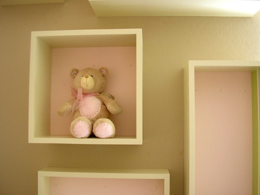 Emma Mary close up of baby room box floating shelf with pink painted back to match adjacent wall fLANSBURG dESIGN