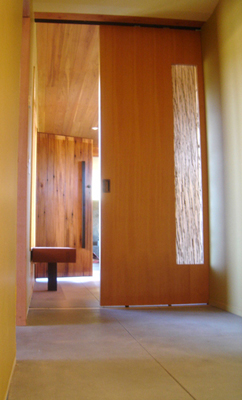Mei Residence Reclaimed Doug Douglas Fir and Genuine Mahogany entrance huge monolithic Birchwood Casey steel 3-form and wood barn door as seen from east wing of residence Jackson Hole Wyoming fLANSBURG dESIGN in collaboration with Aric Mei
